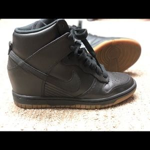 All black Nike wedge sneakers